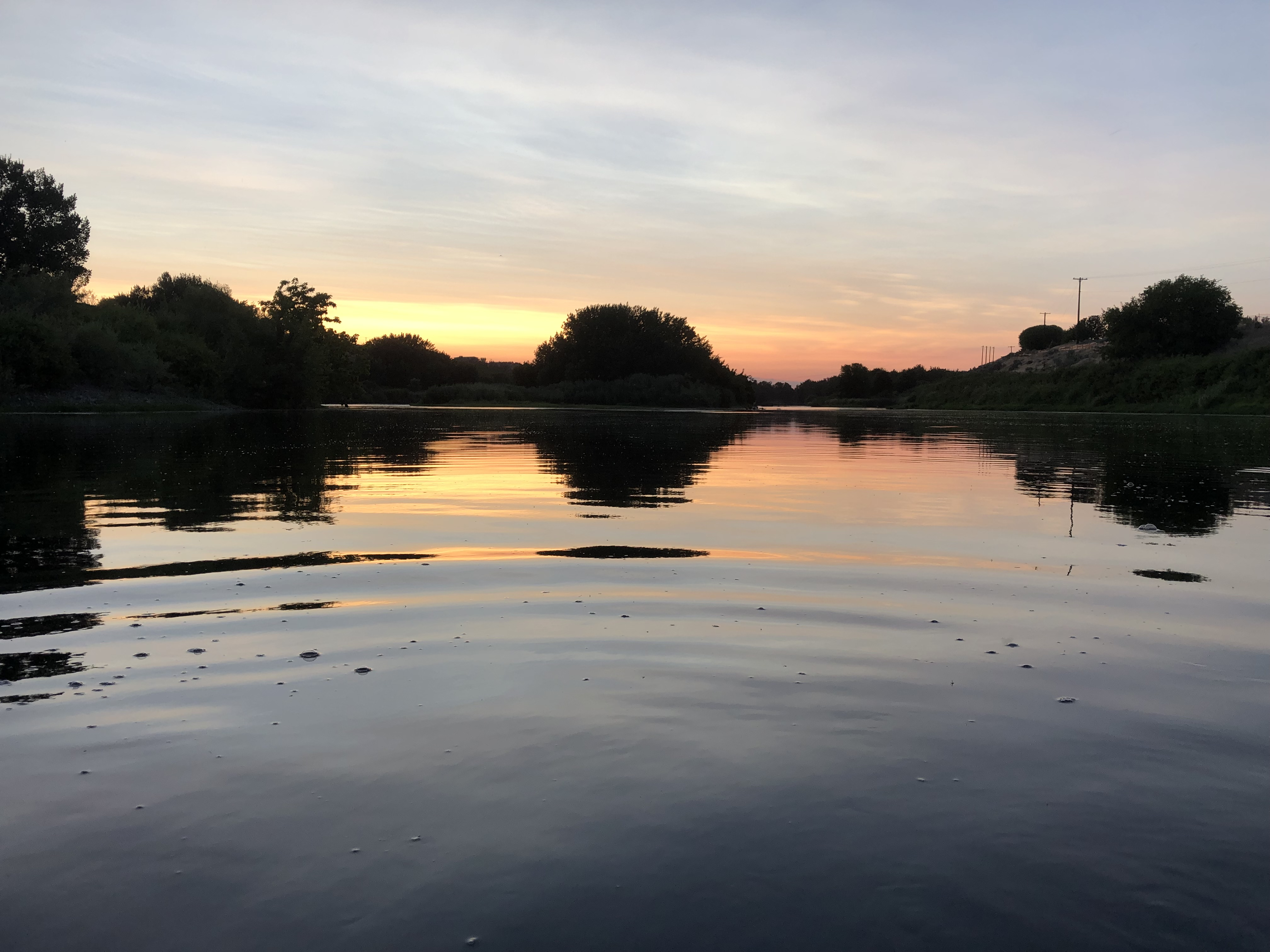 Photo of the river at sunset