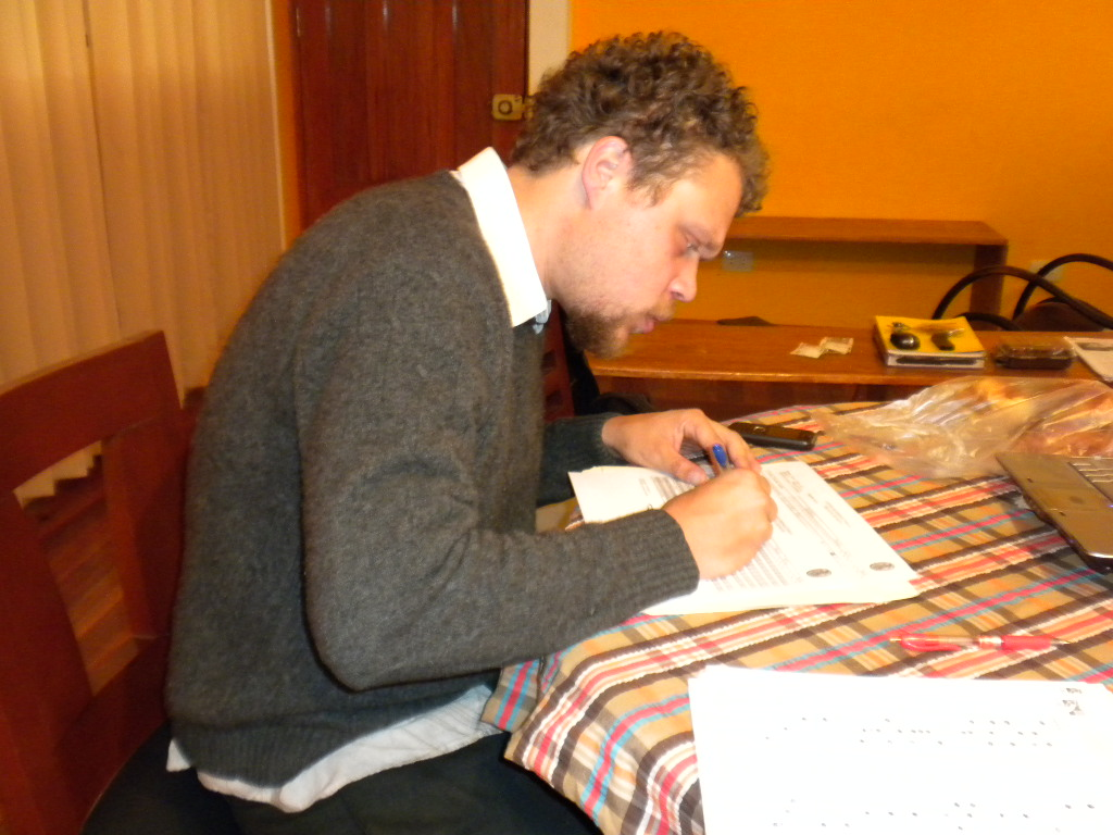 A photo of me grading papers for my students from UNSAAC in Cusco