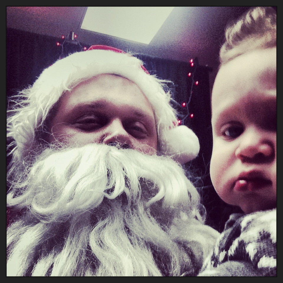 Jacob got to play Santa Claus for Elijah Family Home's Christmas Party This year. Mateo didn't know what to think.
