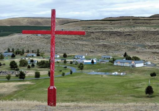 A photo of the cross at the top of the hill overlooking Jubilee Youth Ranch