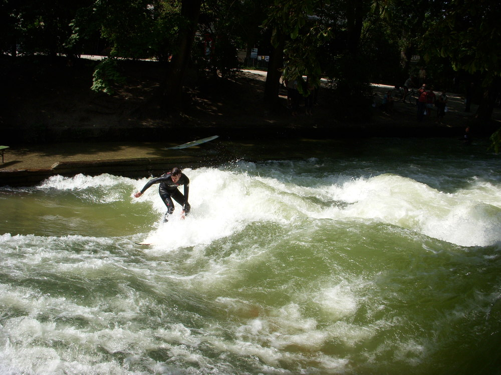A photo of a guy surfing at Englisher Garten. The Englischer Garten, German for