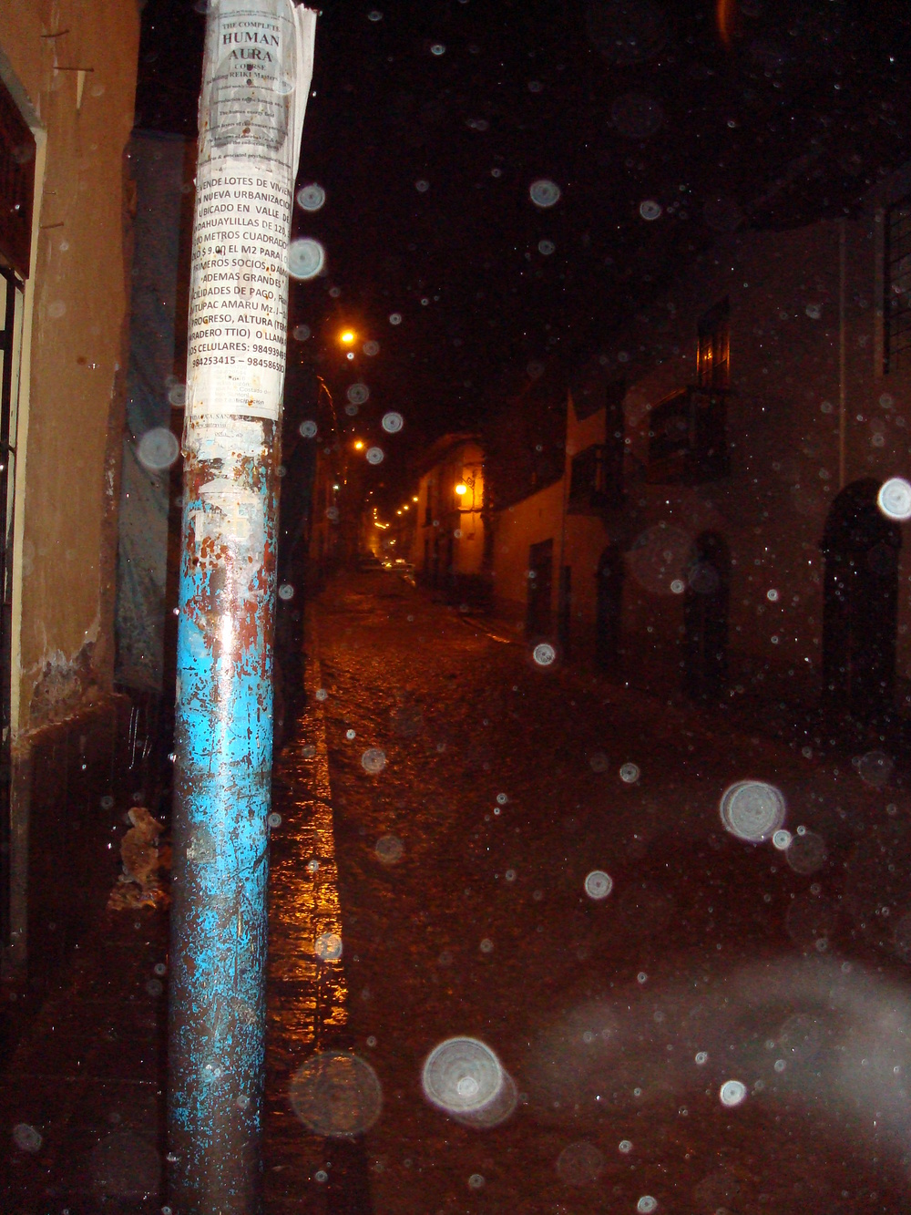 A photo taken by Ami while were both still living down in  Cusco Peru  during my  travel experience  of my  Jaunt Down South 2010. It showcases how during the rainy season in Cusco Peru, the rain really pours down and the streets turn to rivers. During the peak of the rainy season (i.e. December to February) it can have an average of 133.9 inches receiving 401.7 inches of precipitation of the expected annual 707.8 inches per year in just those three months. Read the Wikipedia Article for more information regarding  Cusco's climate .