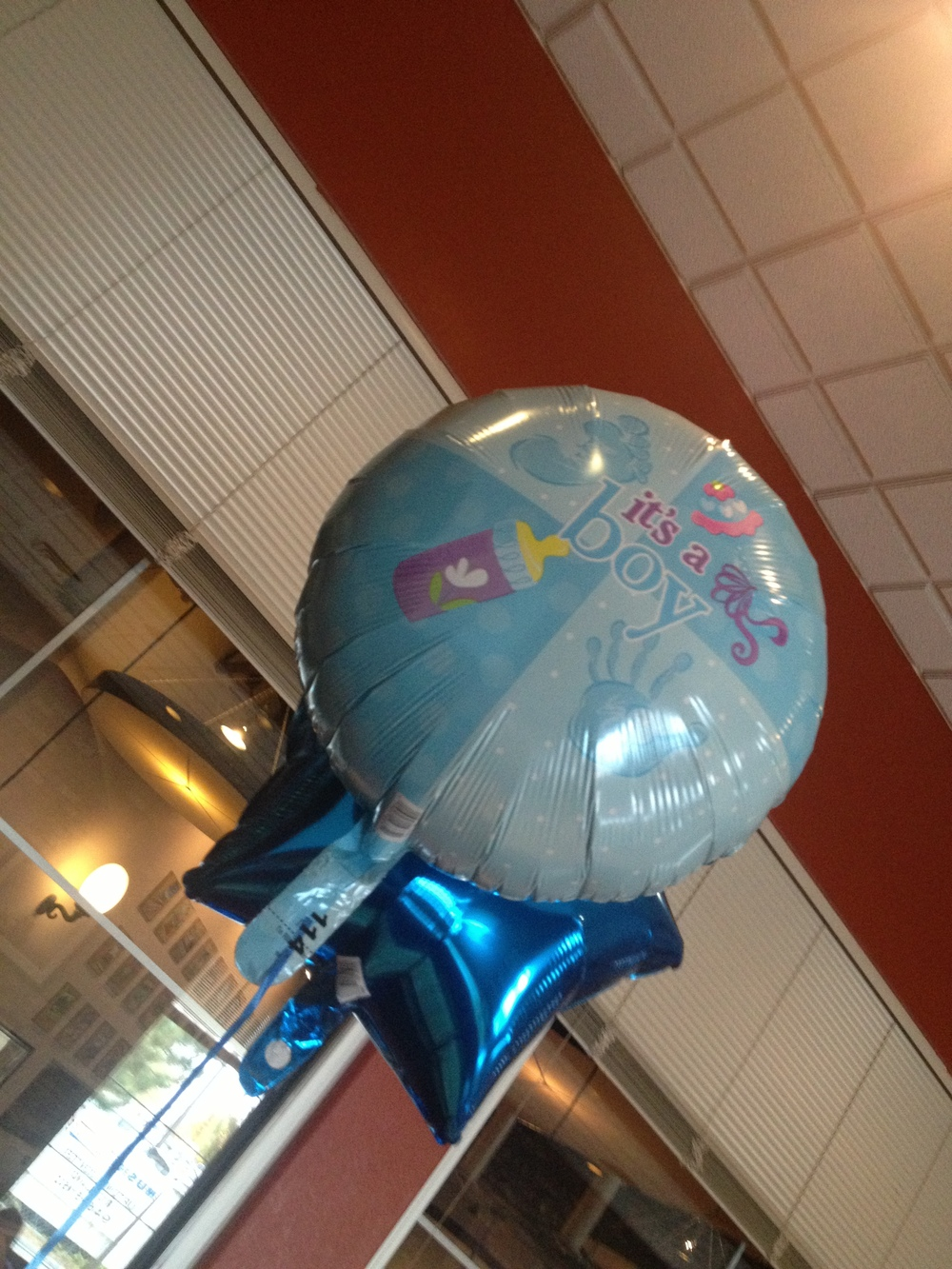 "A photo taken at  Tony Romas for our  Baby Shower. It displays a photo of a balloon that was at our baby shower with the words ""It's a Boy"" written on it."