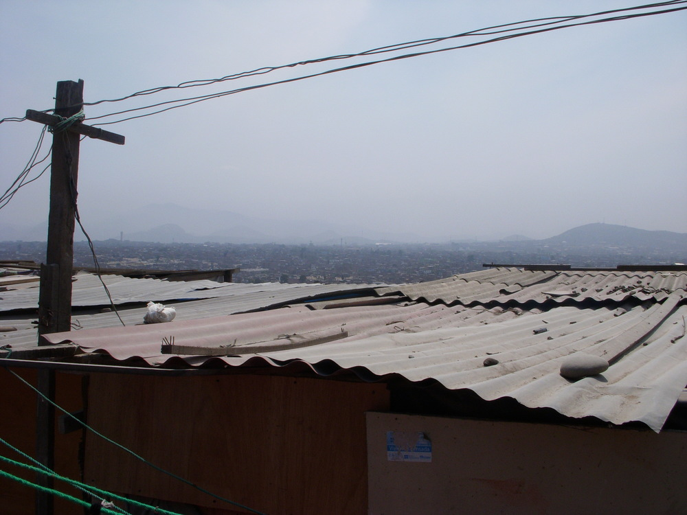 A photo overlooking some of Villa El Salvador. It began as a pueblo jóven (shantytown) in the vast, empty sand flats to the south of Lima in 1970 because of the urgent housing needs of immigrant families who had left the sierra of Peru. Villa El Salvador evolved into a huge urban zone, largely self-organizing, for which it won some fame. Largely through the efforts of its inhabitants, the neighborhood was supplied with electricity, water, and sewage.